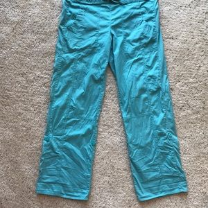 Danskin Now turquoise pants. Can be rolled up. M